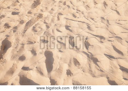 Sand Pattern Of A Beach In The Summer Background.