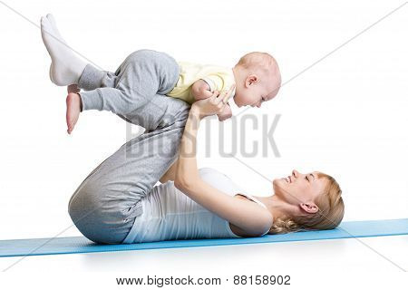 young woman have fun with baby doing fitness exercises