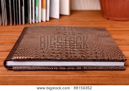 Big brown photo book - Stock Photo