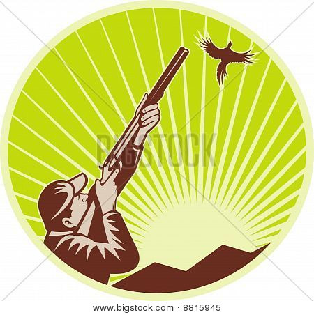 Hunter with shotgun rifle bird