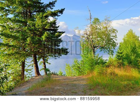Trees And Mountains By Mcdonald Lake In Glacier National Park