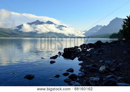 Mountains And Mcdonald Lake In Glacier National Park At Sunset