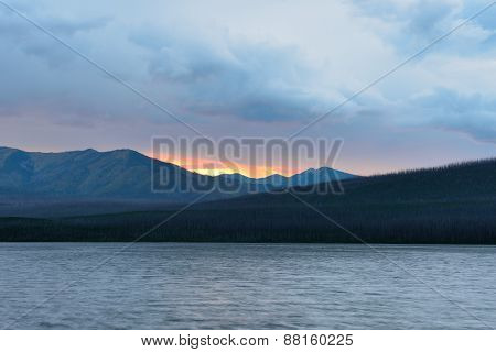 Sunset In The Mountains At Mcdonald Lake In Glacier National Park