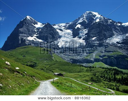 Eiger And Monch Mountains In Switzerland Alps