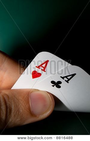 Fingers holding winning cards