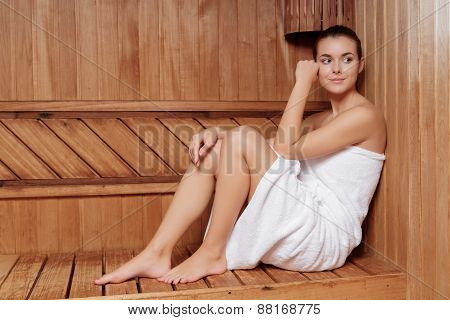 Woman relaxes in sauna