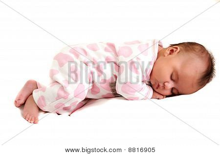 full body photo of newborn baby peaceful and asleep
