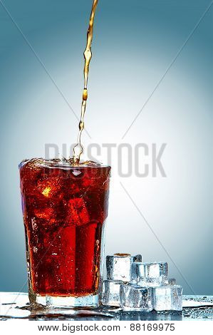 Cola pouring in a glass