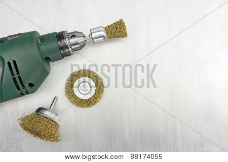 Electric Drill With Rotating Metal Brushes