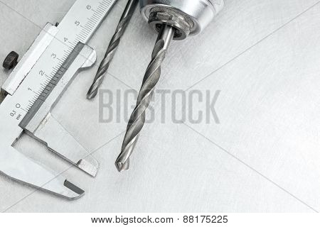 Drill With Drill Bits On Metal Background