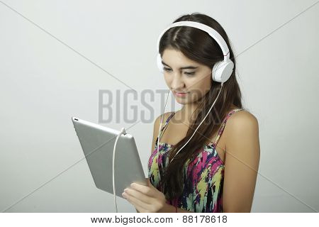 Young woman with tablet pc and headphones