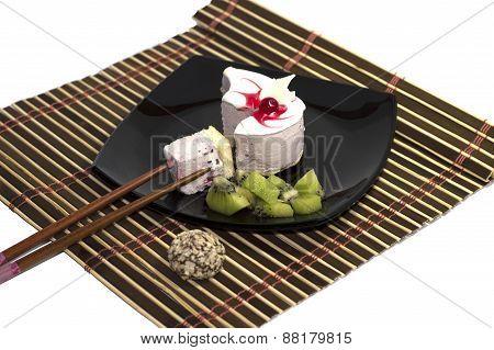 White Cake Together With A Kiwi, With Chopsticks