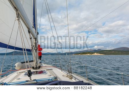 Sailor On A Bow Of Sailing Yacht