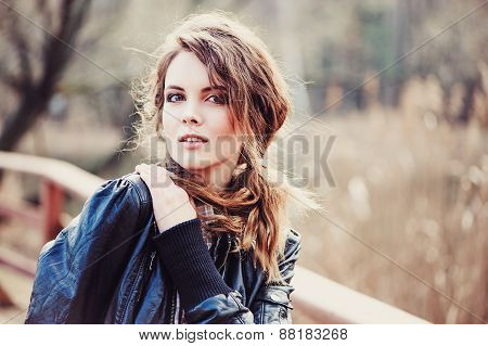 close up outdoor portrait of adorable young woman