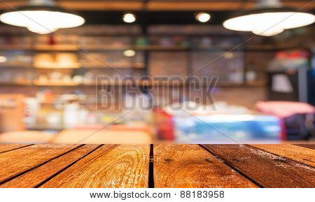 Empty Wood Table And Coffee Shop Blur Background With Bokeh Image