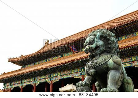 Copper Lion In Front Of An Ancient Architecture