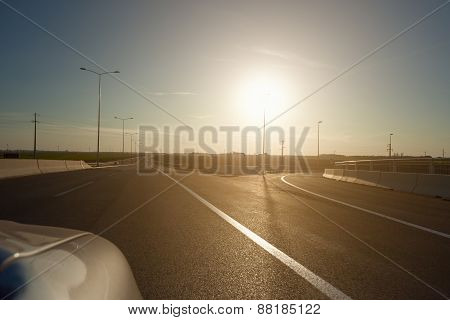 Driving On The Highway At Sunset