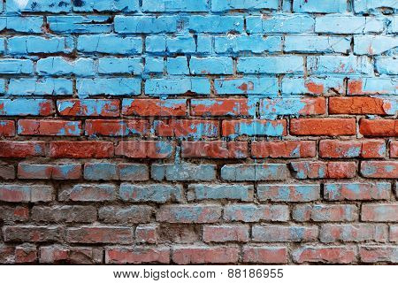 Old red brick wall half painted in bright blue color a lot of copyspace background