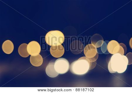 Blurred bokeh background night street for your design, instagram vintage retro color tone copyspace