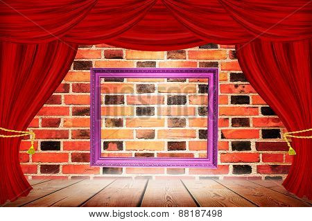 Frame On The Background Of  Red Curtains On  Brick Wall.
