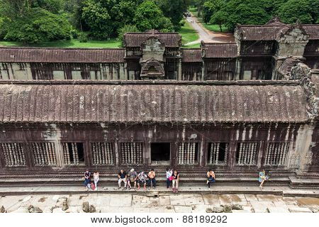 The group of tourists resting in Angkor Wat Temple