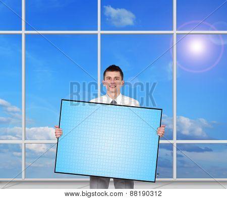 Businessman Holding Blank Plasma Panel