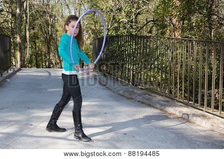 Pretty Girl Ten Years Playing Hula Hoops  In The Park.