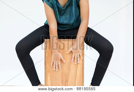 Kid Legs And Hands Are Shown Playing The Cajon Instrument - Isolated On White