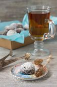 image of sugar  - Chocolate homemade cookies in powdered sugar with tea and caramel sugar on a wooden background - JPG