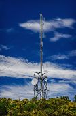 picture of antenna  - Communication tower radio mast with antenna aerial against a background of the blue sky - JPG