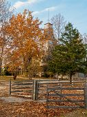 stock photo of burlington  - Batsto Mansion hidden by the Fall foliage of Batsto Village in Burlington County New Jersey - JPG