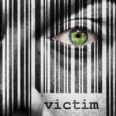 stock photo of superimpose  - Barcode with the word victim as concept superimposed on a man - JPG