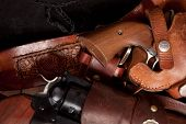 stock photo of revolver  - A close up of two revolvers in holsters - JPG