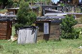 foto of wooden shack  - Wooden houses in an African informal settlement - JPG