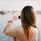 Постер, плакат: Fashion Woman Taking Photo With Cellphone