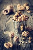 image of walnut  - Walnut kernels and whole walnuts on wooden table - JPG