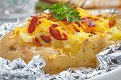 stock photo of baked potato  - Baked potato with bacon - JPG