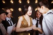 pic of superstars  - Superstar woman wearing golden shining dress crowded by paparazzi - JPG