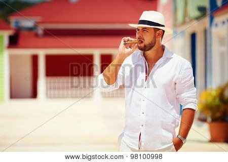 Confident Man Smoking Cigar On Caribbean Street