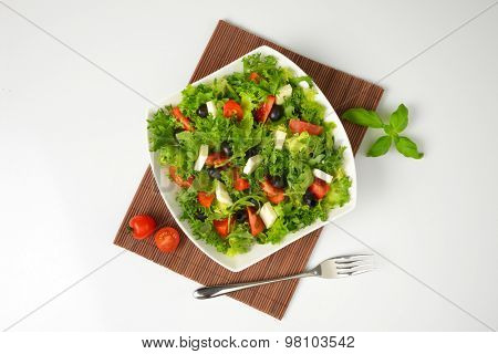 bowl of fresh vegetable salad on brown place mat