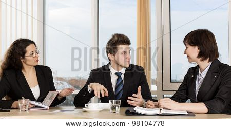 Group of business people discuss working schedule