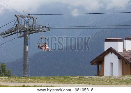 SOCHI, RUSSIA - JULY 23, 2015: Tourists on the ski lift, mountain resort