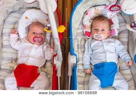 Baby girl and boy twins lying down in the cradle