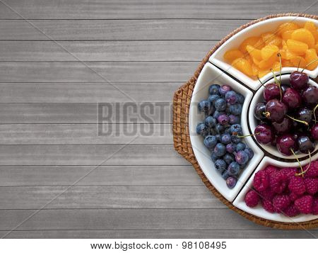 Fruit Bowl On wooden Background