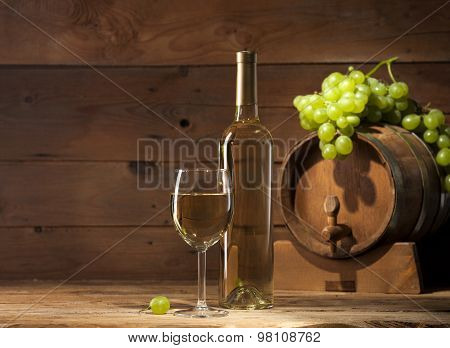 White wine on wooden background
