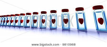 Frascos de vidro médicos com corações
