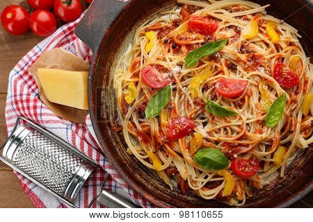 Homemade Spaghetti Bolognese on pan, on wooden background