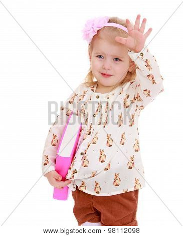 Little girl with book in hand