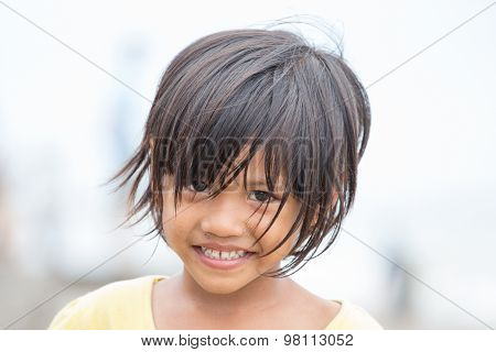Portrait Of A Little Indonesian Girl At The Streets