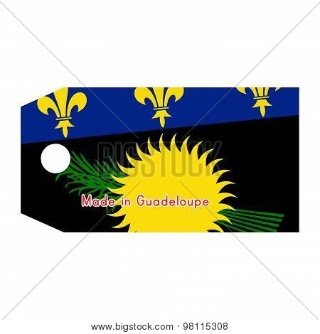 Guadeloupe Flag On Price Tag With Word Made In Guadeloupe Isolated On White Background.
